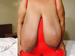 Gloria Stutters plays with her huge tits.