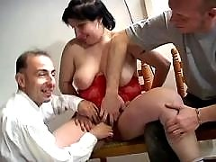 Chubby brunette sucking two cocks