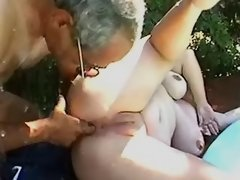 Old man drilling plump lady outdoor